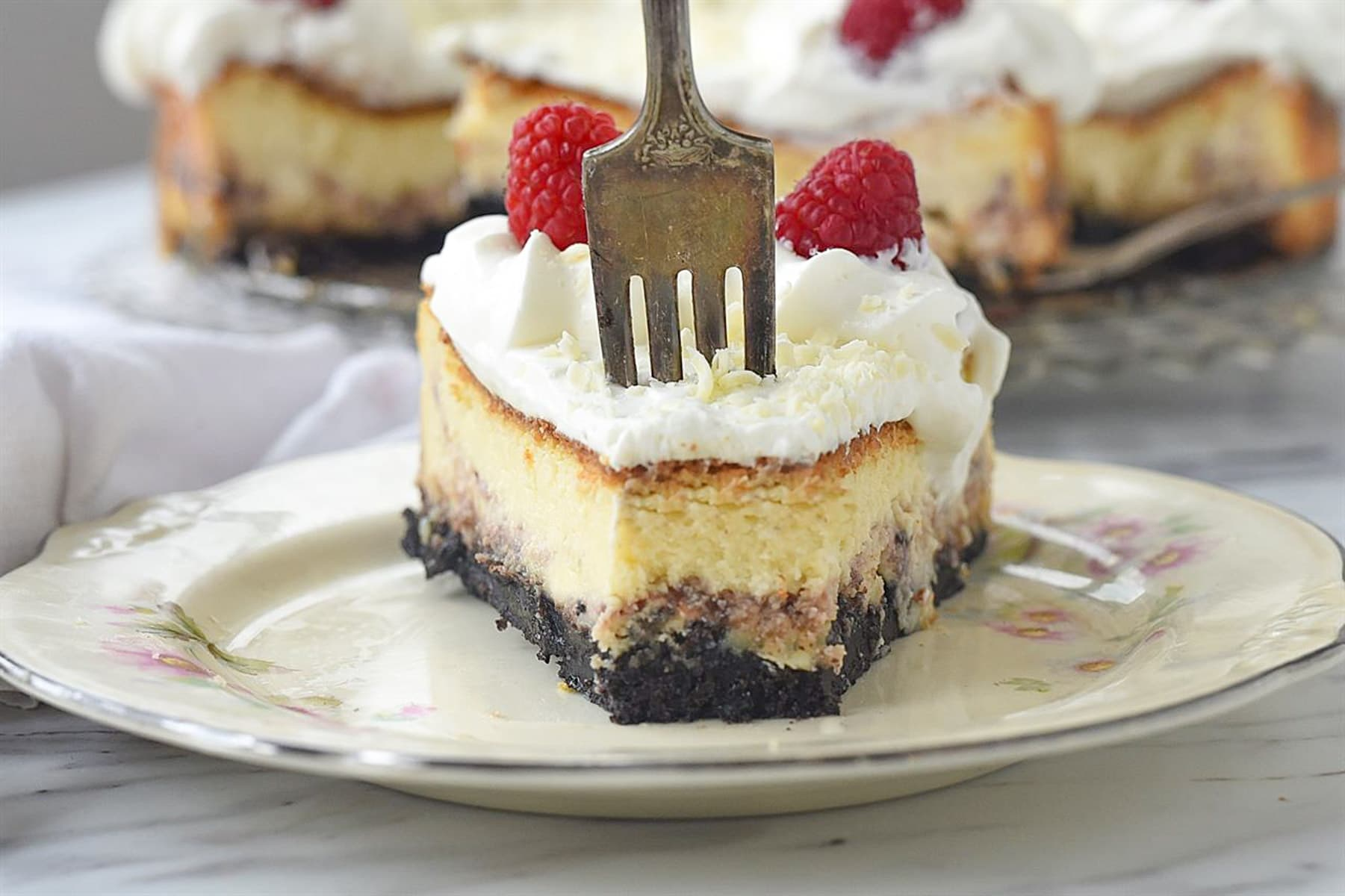 slice of cheesecake with fork in it
