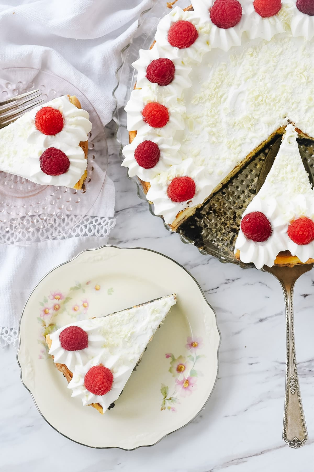 overhead shot of white chocolate raspberry cheesecake