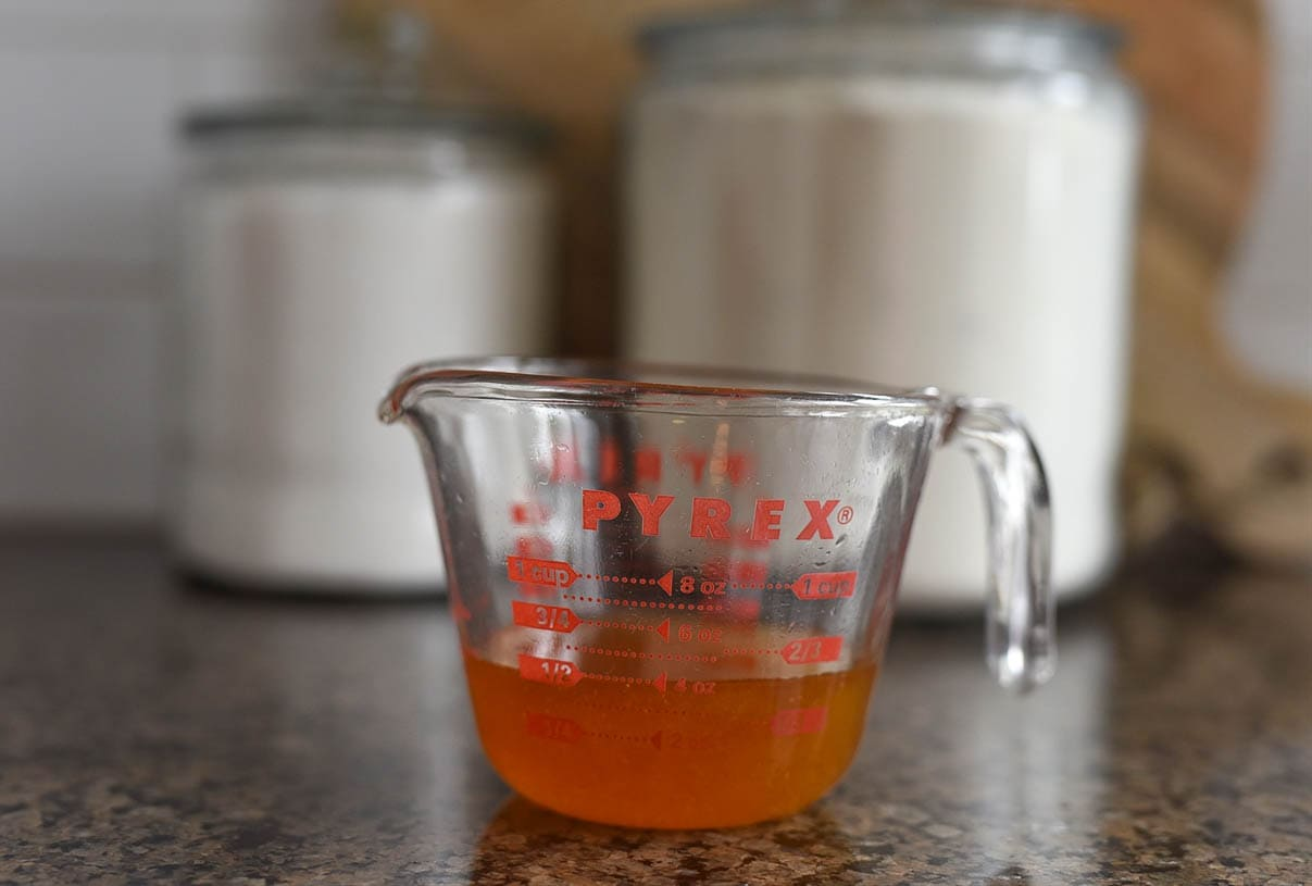 honey in a measuring cup