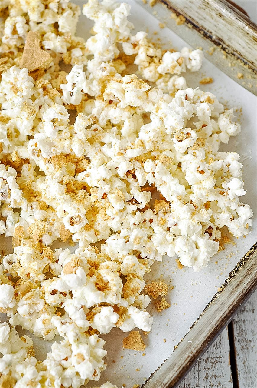 white chocolate popcorn on baking sheet