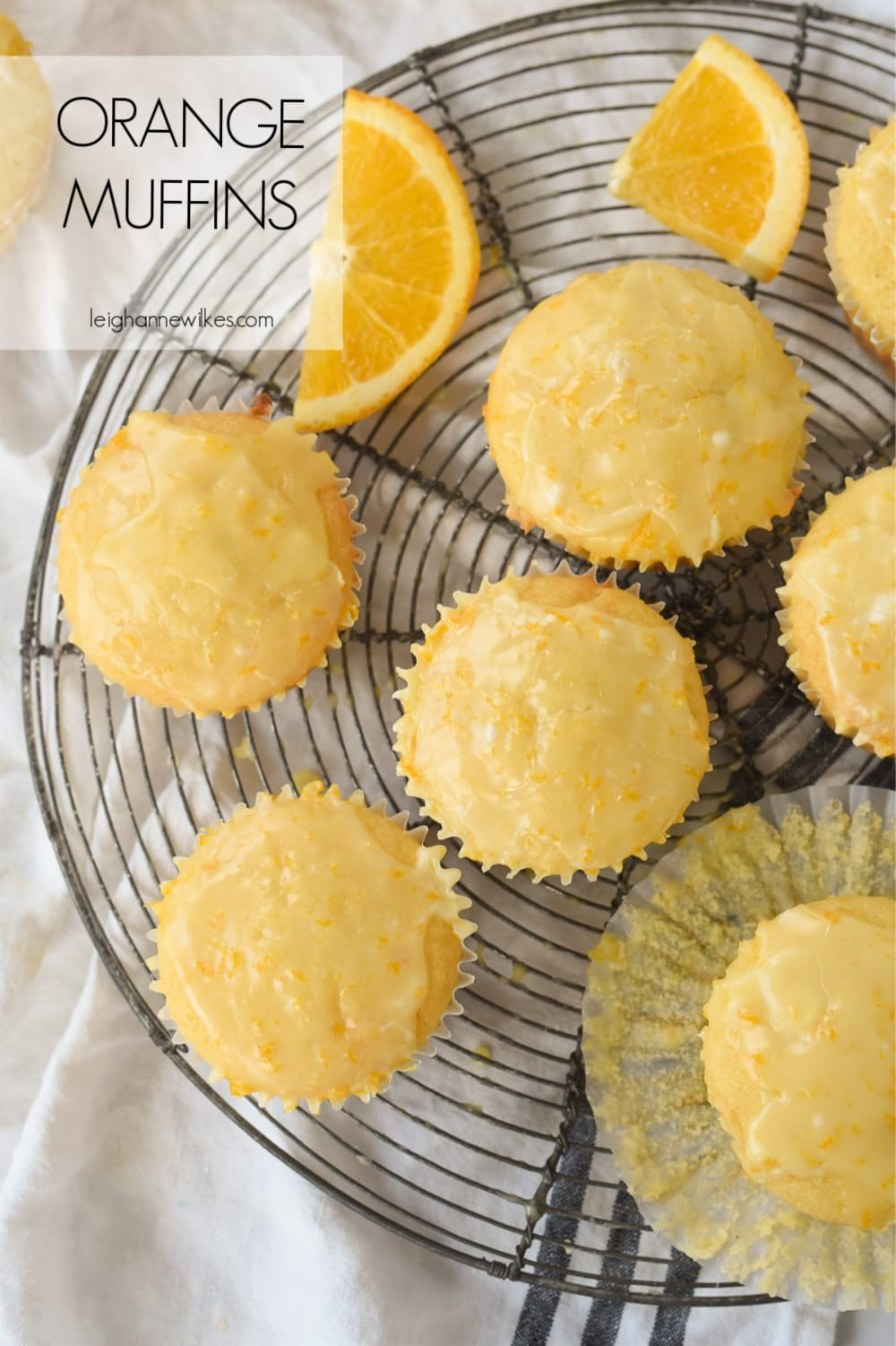 overhead shot of orange muffins on a cooling rack