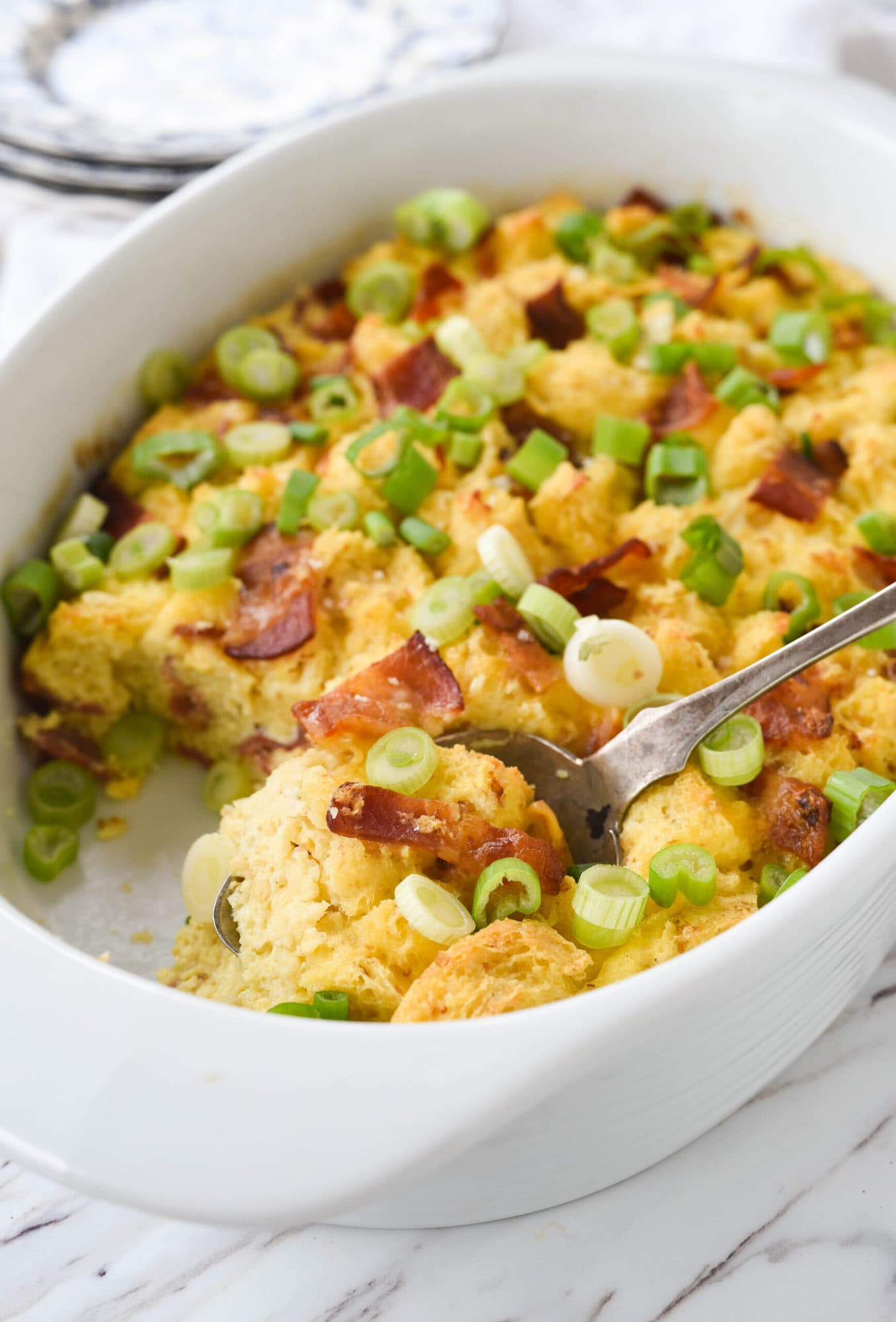 bacon casserole with a spoon
