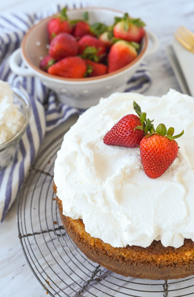 Buttermilk cake with whipped cream and strawberries