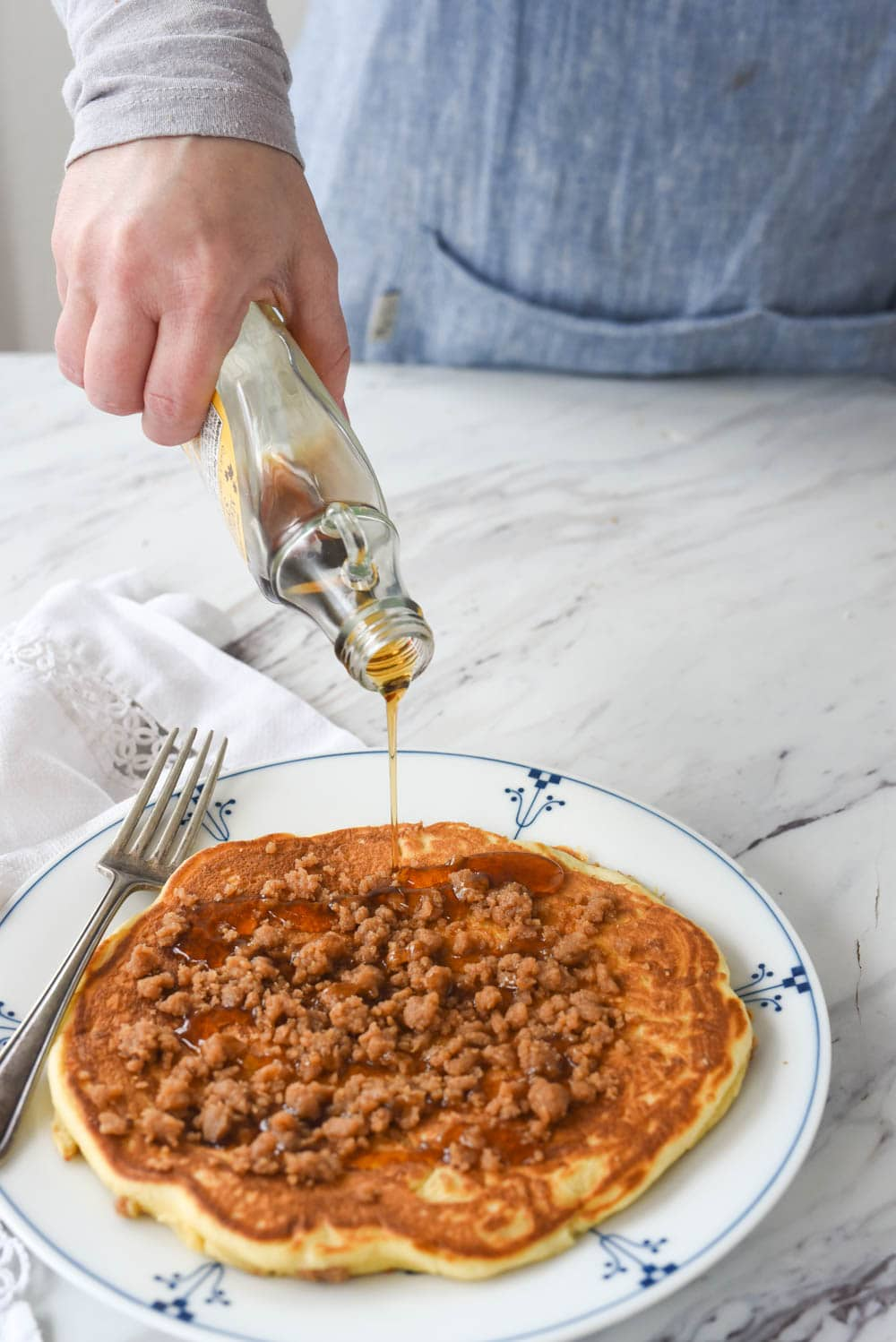 pouring syrup on streusel pancake