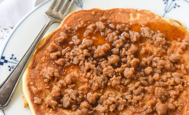 large cinnamon streusel pancake on a plate