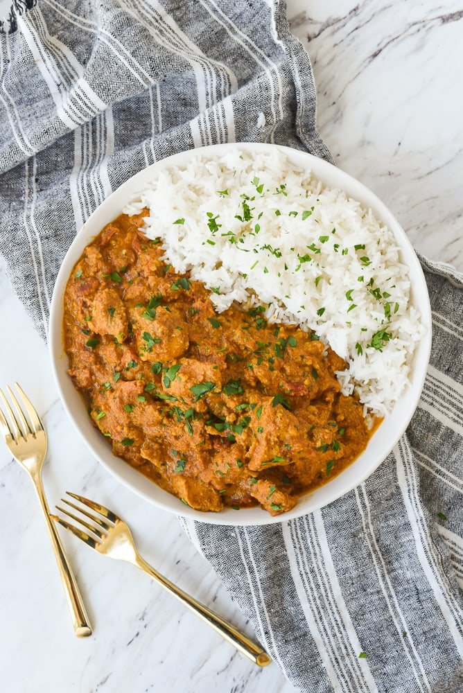 overhead shot of butter chicken in a bowl