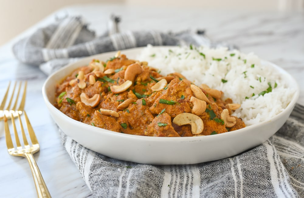 butter chicken with rice in a bowl