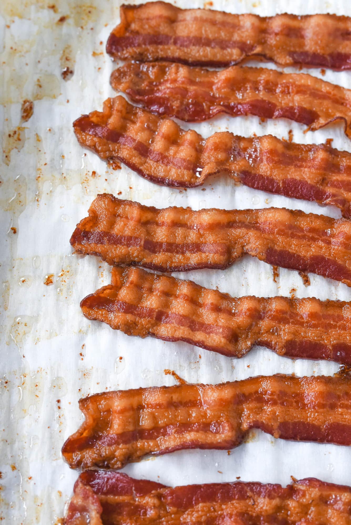 strips of cooked bacon on parchment paper