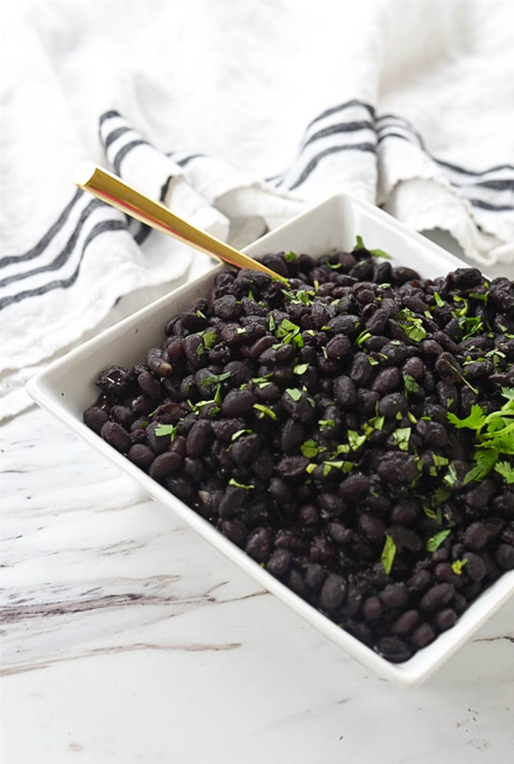 black beans in bowl with a spoon