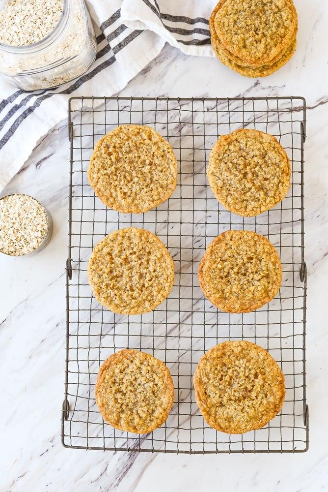 overhead shot of crispy oatmeal cookies on a cooling rack