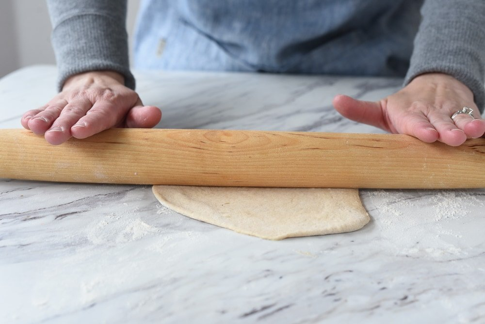 rolling out a pita pocket