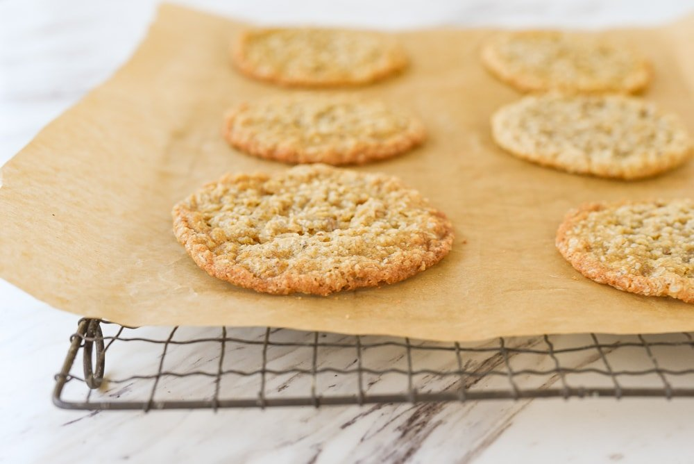 crispy oatmeal cookie on parchment paper