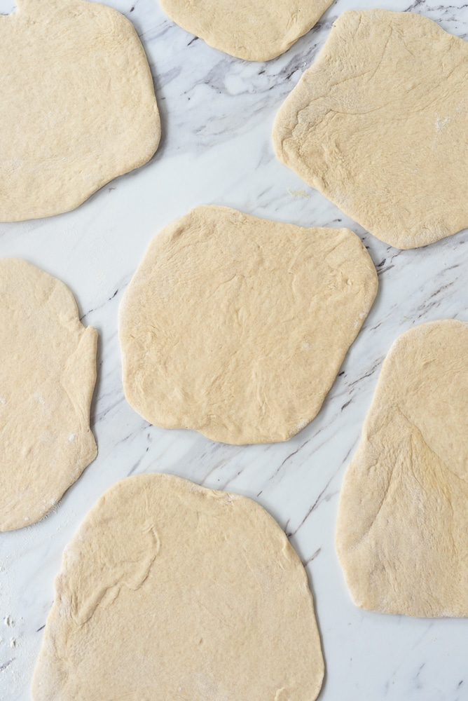 rolled out pita bread dough