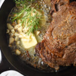butter in pan with steak