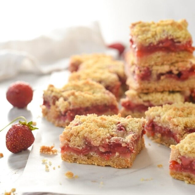 pile of strawberry bars on parchment paper