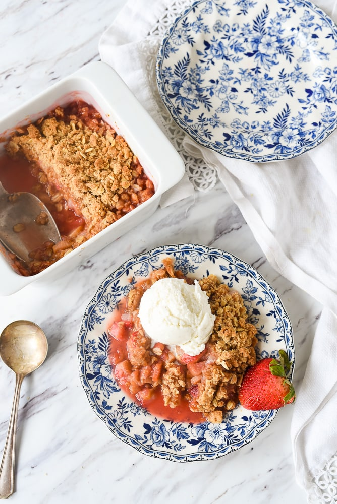 plate of strawberry rhubarb crisp with ice cream