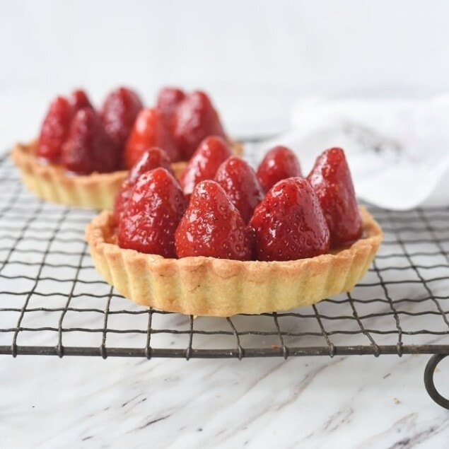 fresh strawberry tart on a cooling rack