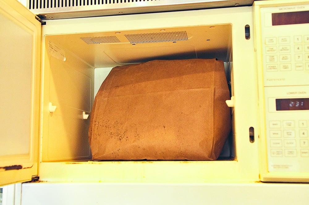 brown paper bag in microwave.