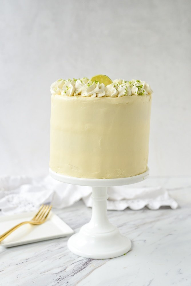 key lime cake on a white cake stand