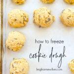 frozen balls of cookie dough on a baking sheet