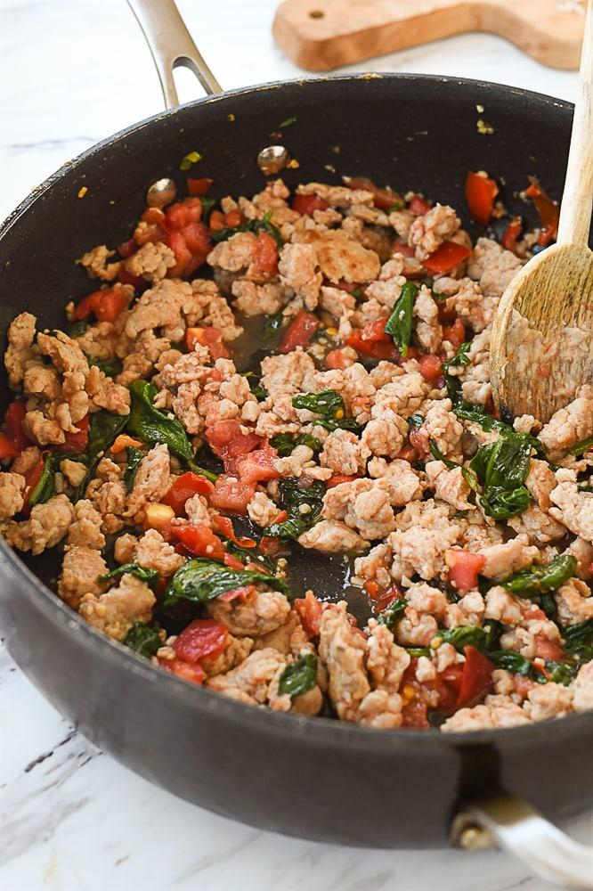 pan of chicken sausage cooking