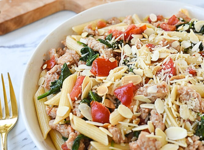 white bowl of chicken sausage pasta