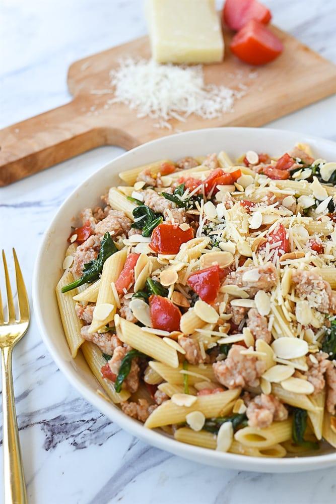 white bowl of chicken sausage pasta