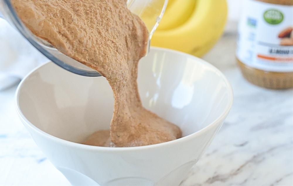 pouring chocolate almond milk smoothie into bowl