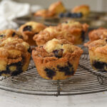 cooling rack of blueberry muffins