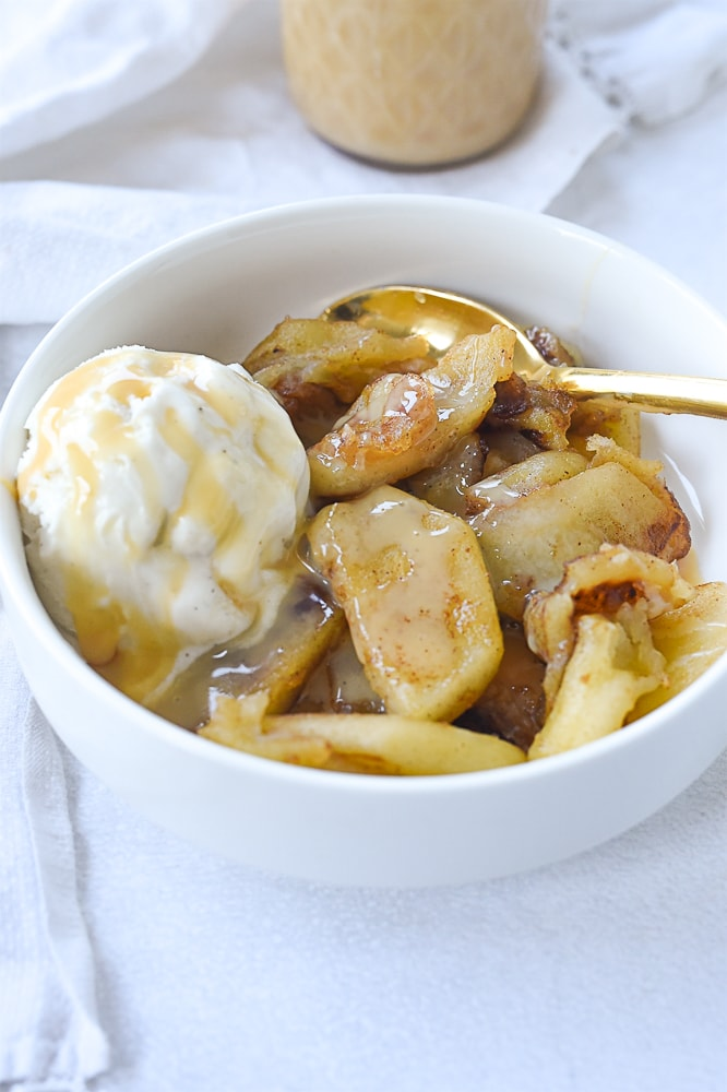 bowl of caramlized apples and ice cream