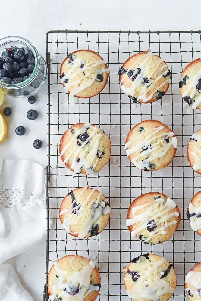 blueberry lemon muffins on a cooling rack