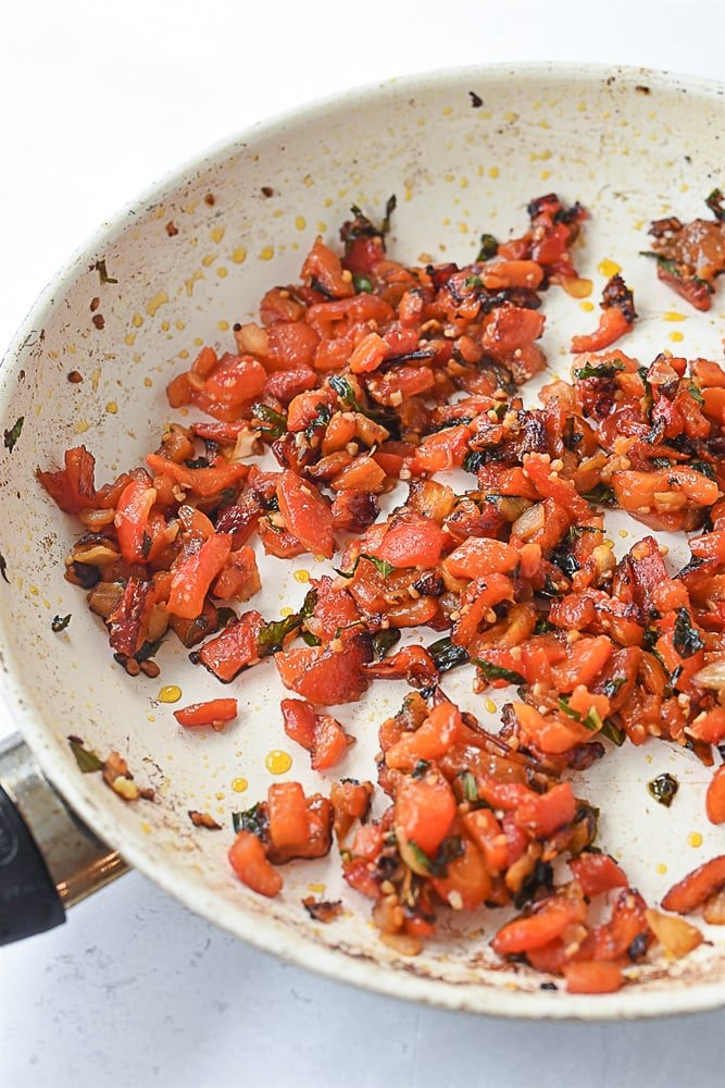 diced roasted red pepper in pan