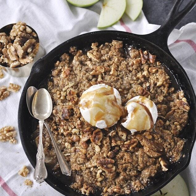 cast iron pan of apple walnut crisp