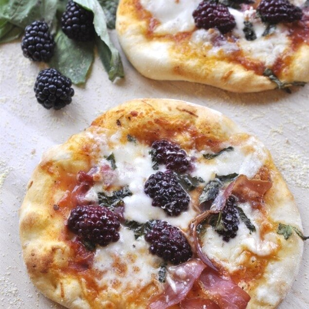 pizza with blackberries and proscuitto