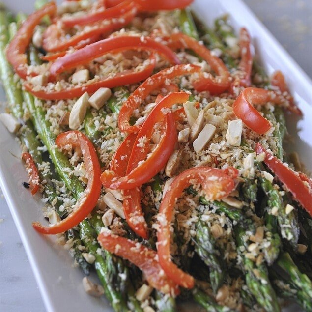 plate of asparagus with red peppers