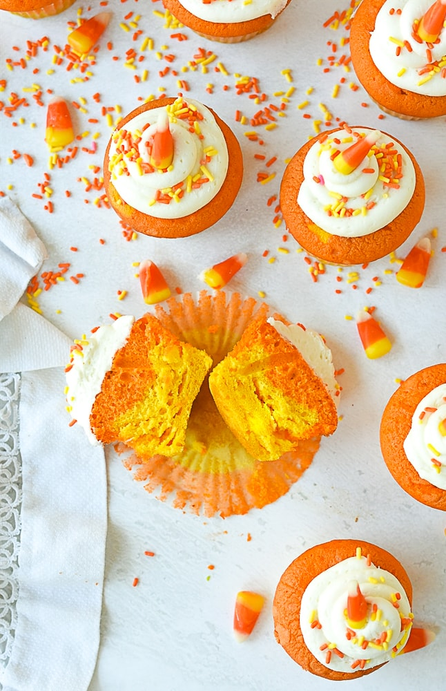 sliced open candy corn cupcake