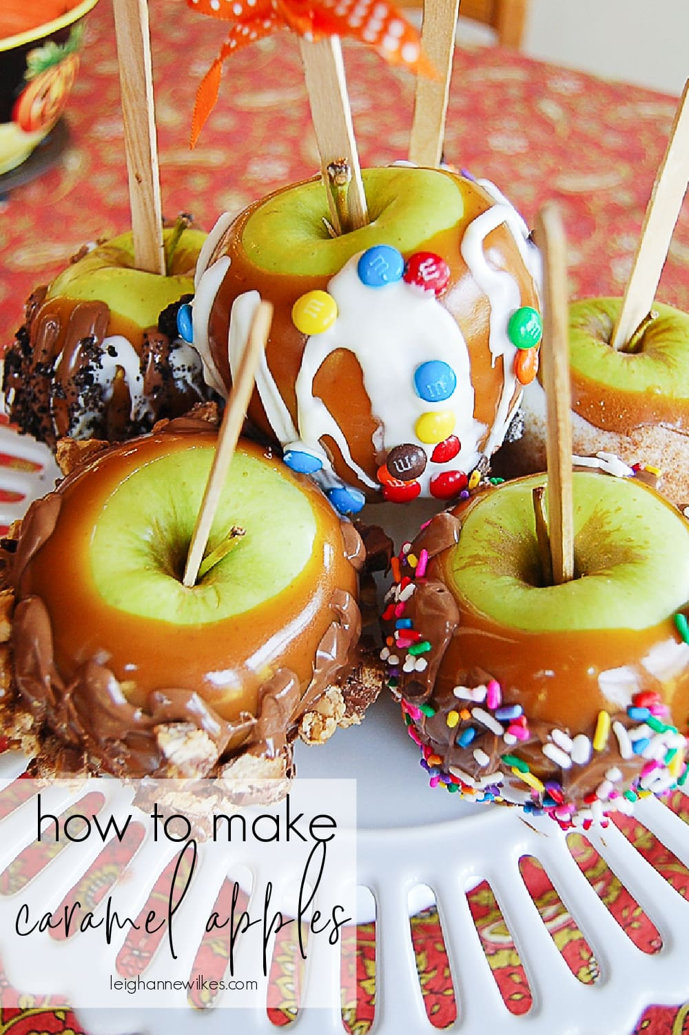 pile of caramel apples on a plate