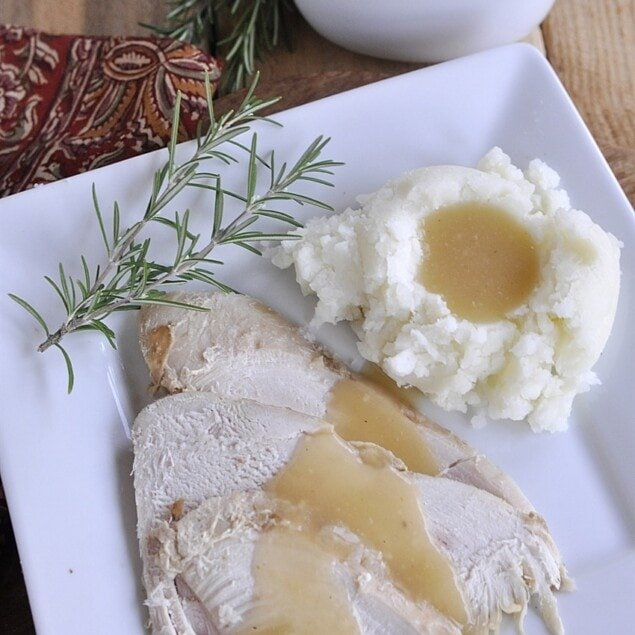 slices of turkey with gravy