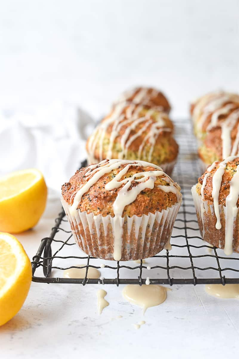 lemon poppy seed muffins on a cooling rack