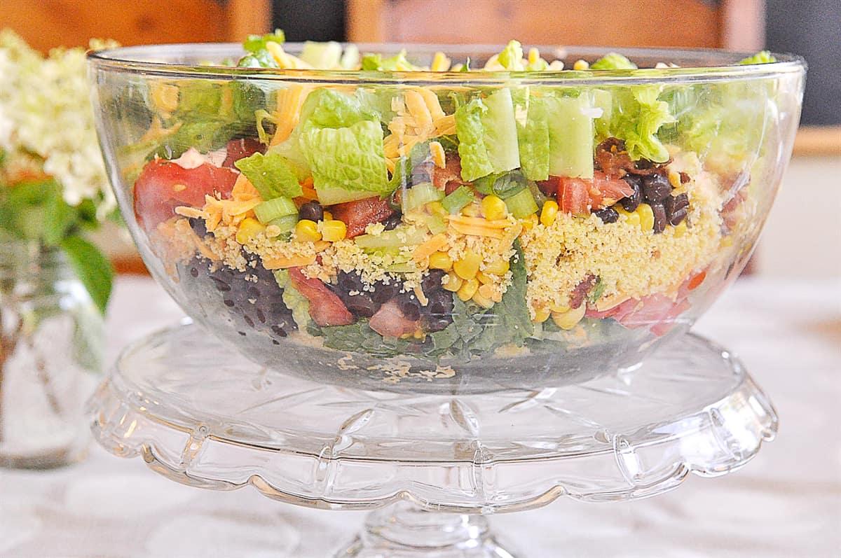 bowl of layered mexican cornbread salad