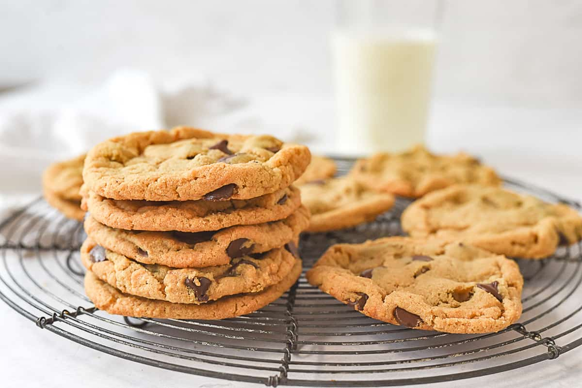 stack of peanut butter cookies with a glass of milk