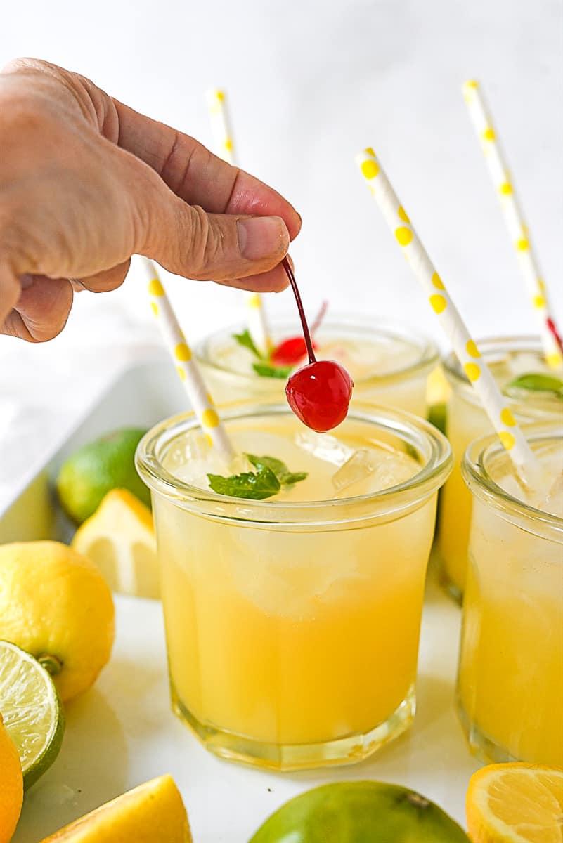 adding a cherry to lemonade