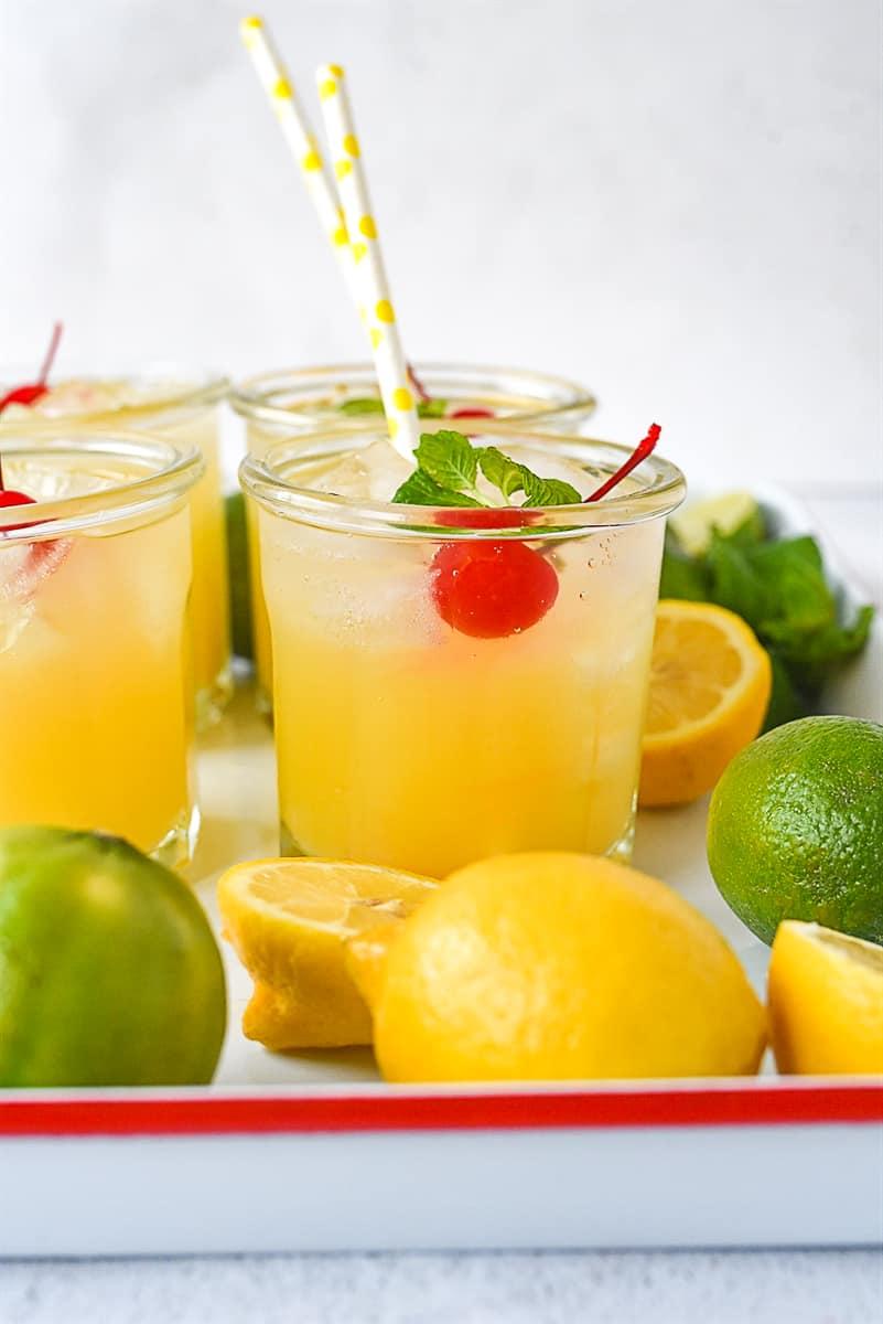 glasses of sparkling orange lemonade with a cherry