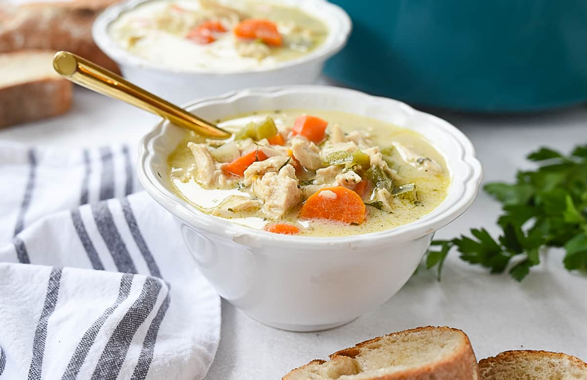 white bowl of turkey soup