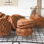 chocolate sandwich cookies on a rack