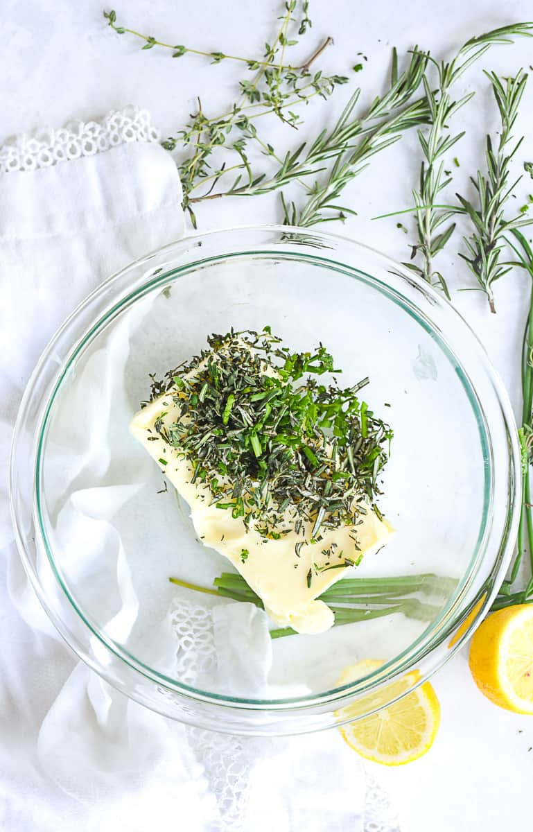 butter and herbs in a bowl