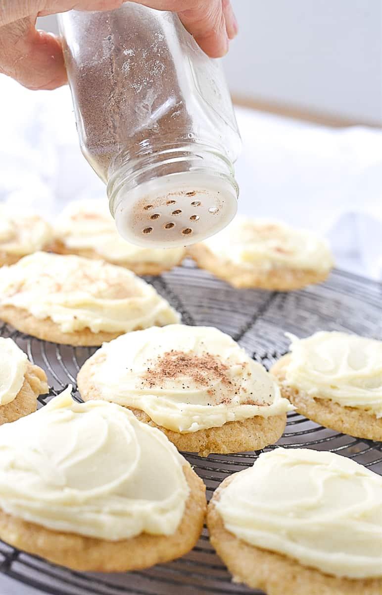 sprinkling nutmeg on cookies