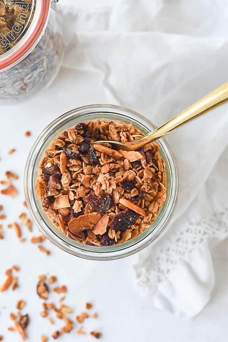 open jar of granola with spoon in it