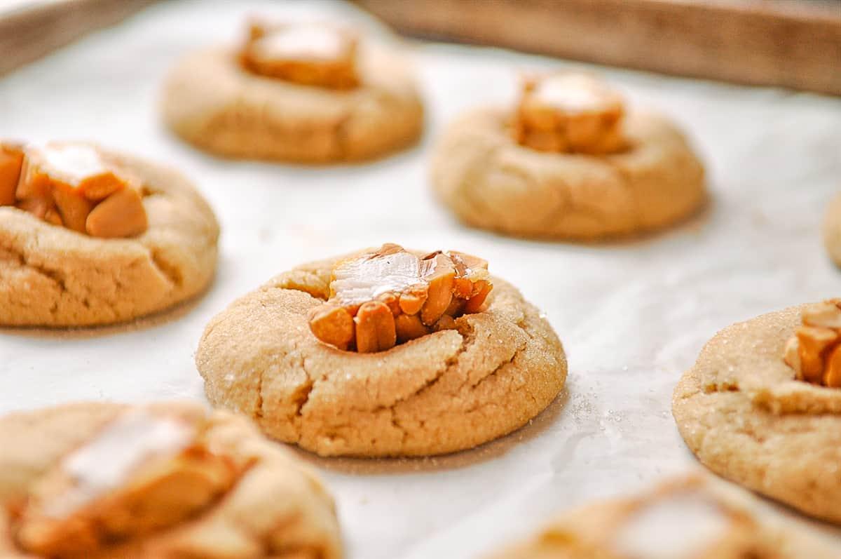 peanut butter blossoms on a baking sheet