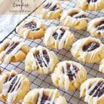 cooling rack of raspberry shortbread cookies
